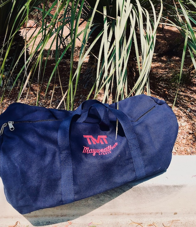 """367256867f8665 ... Bag"""" duffle bags, available in black and gold, army green and black,  and navy and pink colorways. Shop TMT apparel and merchandise right here ..."""